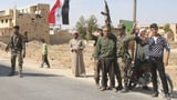 Syrische Truppen unterstützen Kurden in Manbidsch (Artikel enthält Video)