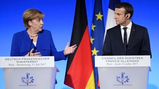 Emmanuel Macron hat viel zu tun: Zuerst politisiert er mit Angela Merkel, dann empfängt er Donald Trump als Ehrengast.