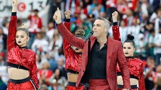 Festa d'avertura plain colurs e Robbie Williams