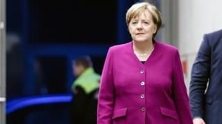 Merkel will bleiben und wehrt sich