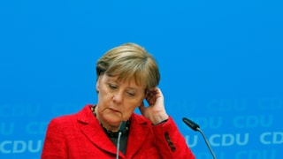 Merkel hält an ihrer Flüchtlingspolitik fest