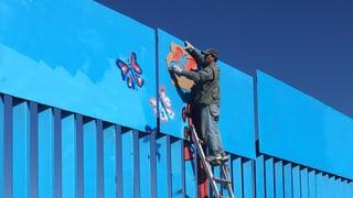 Wie eine Grenze die Menschen vereint: Familien, Paare, Freunde – sie alle entzweit die Grenze zwischen Mexiko und den USA. Ein Künstler kämpft dagegen an.