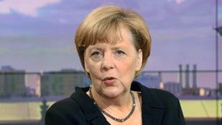 Merkel verteidigt Waffenlieferung an Kurden