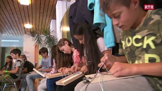 Scolaras e scolars fan bratschlets