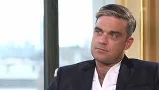 Robbie Williams: «Ich wickle, bade und schöppele meine Tochter»