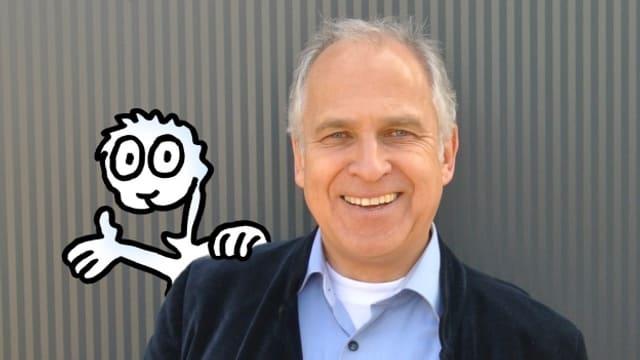 Werner Tiki Küstenmacher ist Buchautor, Karikaturist und Theologe.