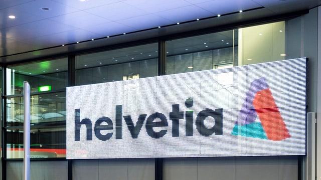 Logo der Helvetia in einem Konferenzraum