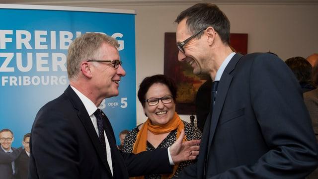 Jean-Pierre Siggen (san.) PCD, e Olivier Curty, PCD suenter lur elecziun en la regenza.