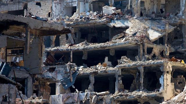 Ina chasa destruida en Siria.
