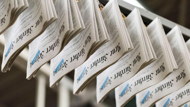 En la stamparia da la NZZ: Avant in onn era il gudogn bun il dubel uschè gronds.