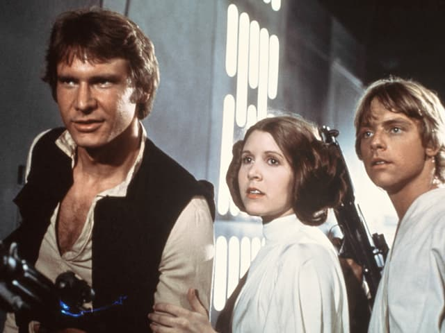 Harrison Ford sco Han Solo, Carrie Fisher sco princessa Leia e Marc Hamill sco Luke Skywalker.