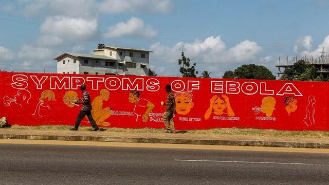Wand mit Infos über Ebola bemalt.