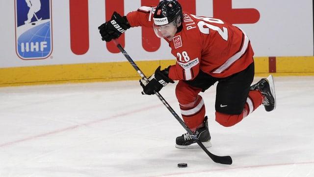 Martin Plüss en acziun durant il campiunadi mundial 2013.