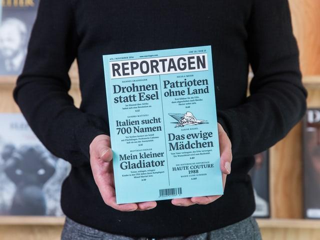 """Titelbild der Zeitschrift """"Reportagen"""", von einer Person in den Händen gehalten."""