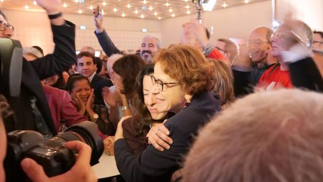 Women hug each other
