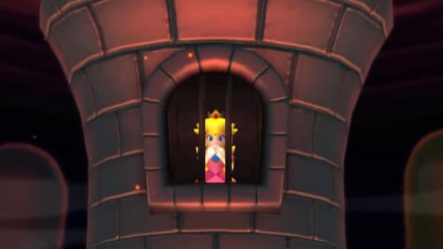 Princess Peach wartet in einem Turm hinter Gittern auf ihren Retter.