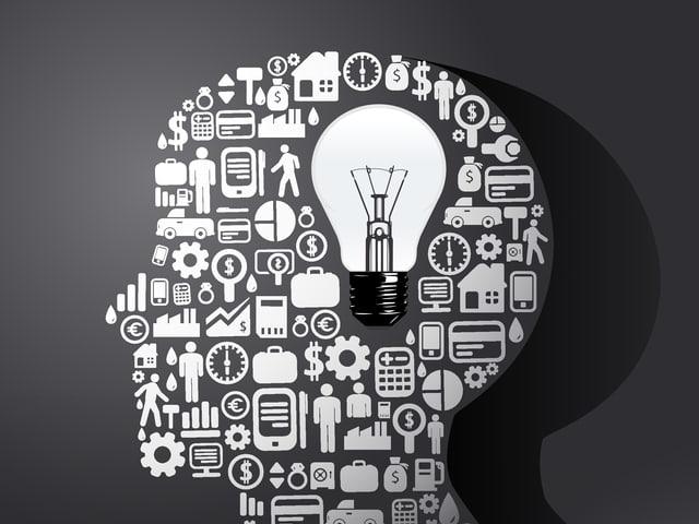 Die Grafik zeigt einen menschlichen Kopf – gefüllt mit Symbolen für Wissen und Erinnerungen.