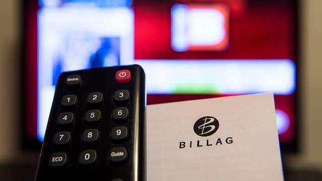 Purtret d'in telecomander ed il logo da la Billag.