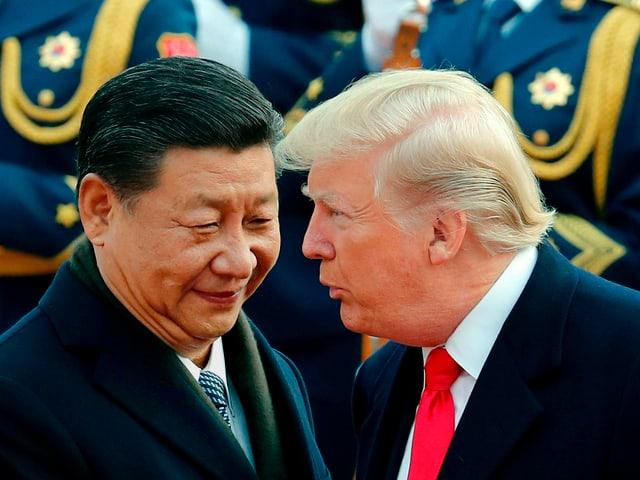 Xi Jinping und Donald Trump im Gespräch.