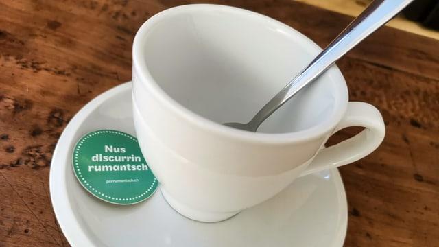 Il slogan dal café rumantsch – «Nus discurrin rumantsch»