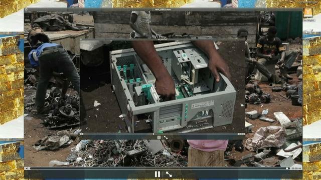 Kinderhände auf einer Müllhalde, die einen Compute demontieren.