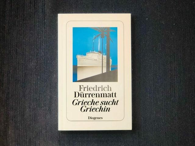 «Grieche sucht Griechin» von Friedrich Dürrenmatt liegt auf einem dunklen Sessel