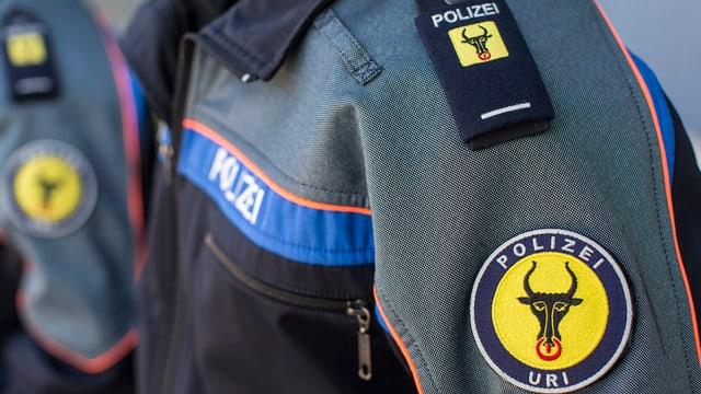 Urner Polizist mit Abzeichen.