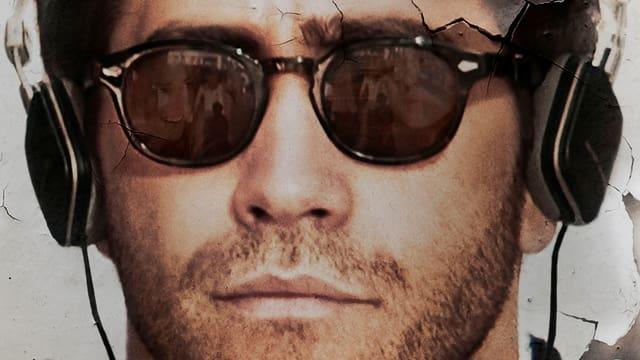 Ausschnitt des Filmposter mit Close-up von Jake Gyllenhaals Gesicht mit Sonnenbrille und Kopfhörern.