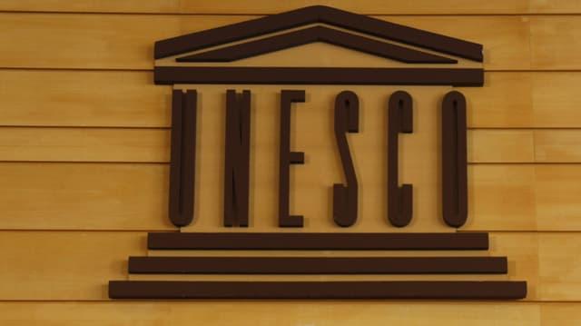 Il logo da l'UNESCO sin ina parait da lain.