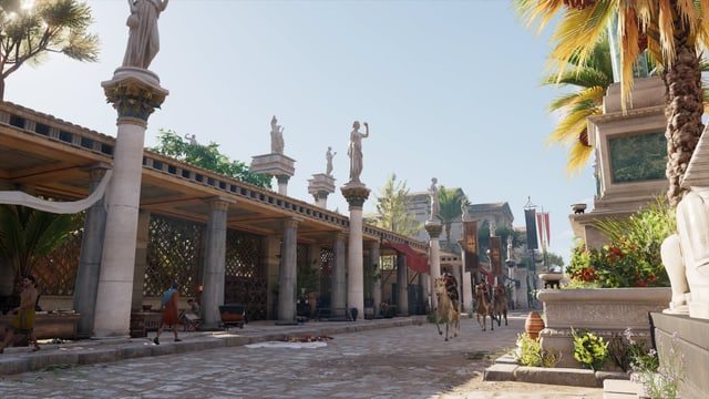 Eine Strasse mit Statuen und Reitern.
