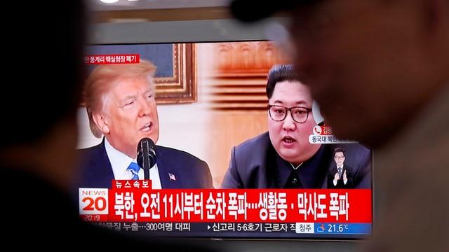 Eine Fernsehaufnahme zeigt US-Präsident Donald Trump und den nordkoreanischen Machthaber Kim Jong-un.