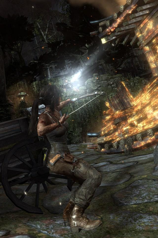 Ein Screenshot des Games «Tomb Raider» zeigt die Hauptfigur Lara Croft beim Benutzen eines Pfeilbogens.