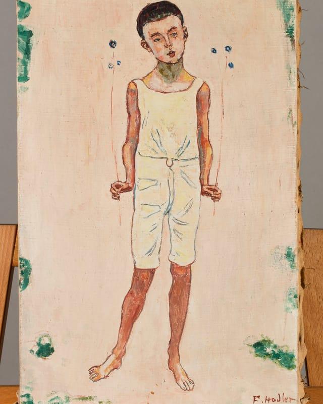 Ein Gemälde mit einem Knaben drauf, in weiss gekleidet.