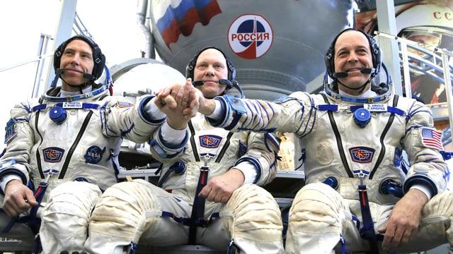 Die drei Kosmonauten Oleg Artemjew, Andrew Feustel und Richard Arnold.