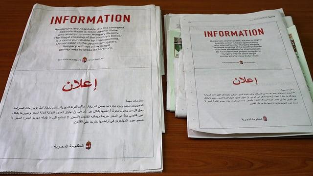 Zeitungsanzeigen der ungarischen Regierung auf Englisch und Arabisch