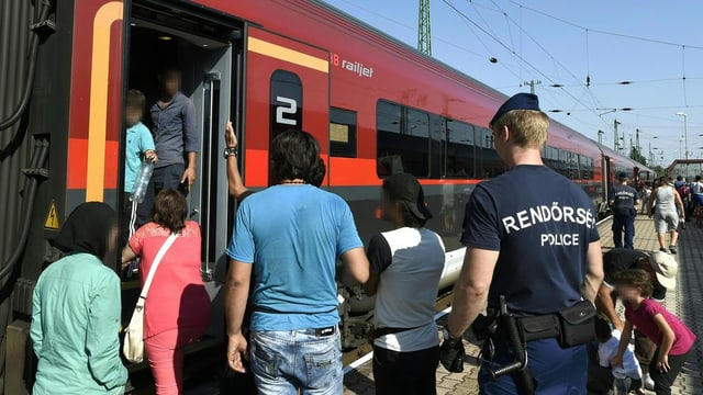 Fugitivs van a bord d'in tren.