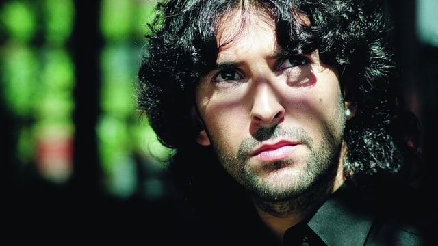 Porträtsfoto von José Arcángel Ramos.