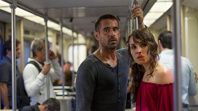 Die beiden Hauptdarsteller von «Dead Man Down», Colin Farrell alias Victor und Noomi Rapace (Beatrice), blutbefleckt  in einem Subway-Zug.