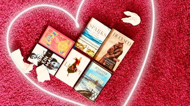 Die neuen Bücher von Frederica de Cesco, Jennifer Egan, Nicholas Sparks, Paul Coelho, Minna Rytisalo und Kathleen Collins zu einem Herz auf einen roten Teppich gelegt