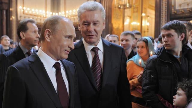 Putin und Sobjanin in der Kirche