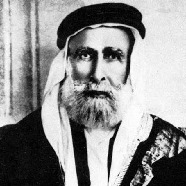 Altes Schwarz-Weiss-Foto: Hussein ibn Ali mit Kopftuch und Bart