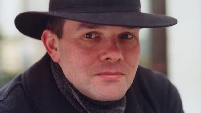 Portrait von Thomas Binotto mit Hut.