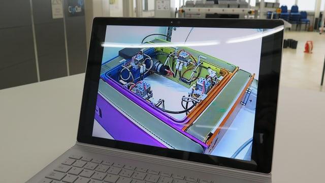 Laptop mit Livestream eines Arbeitsplatzes.