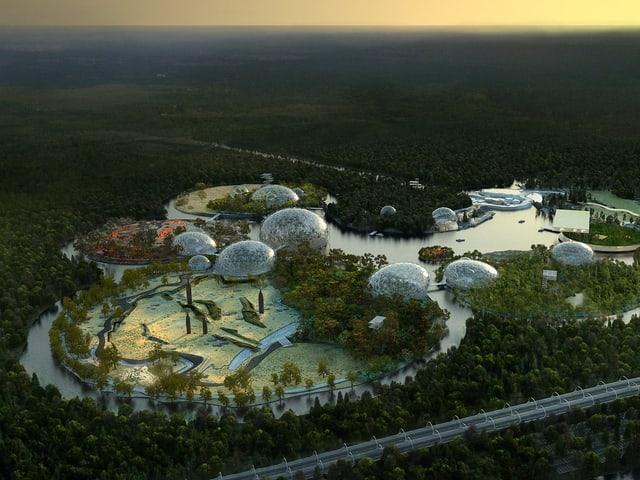 Ein futuristische Anlage mit Wasser und kugelförmig überbauten Inseln in einem Wald.