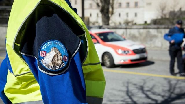 purtret d'in policist u ina policista dal chantun Vallais.