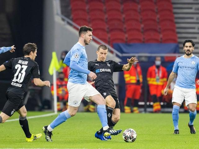 Manchester City und Gladbach.