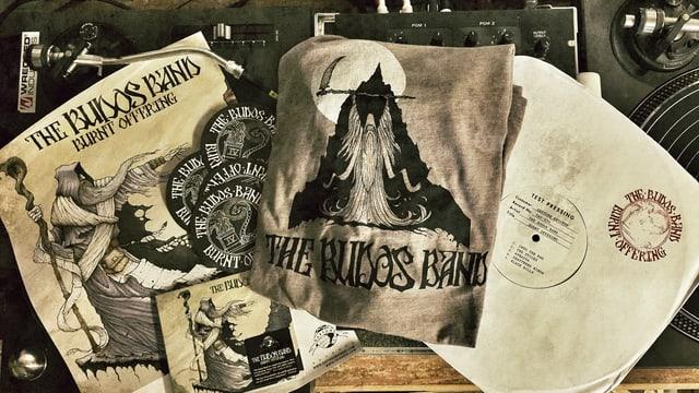 Poster, CD, T-Shirt, Bierdeckel und eine Vinyl-Testpressung der Budos Band