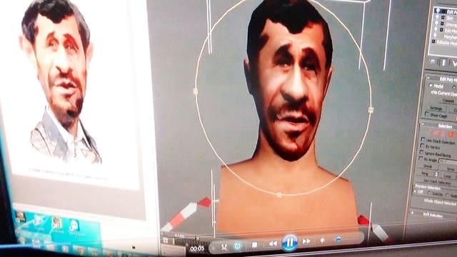 Der ehemalige iranische Präsidenten Ahmadinedschad erscheint als digitales Bild auf einem Computerbildschirm.