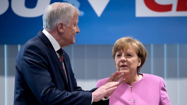 Purtret da Merkel e Seehofer.