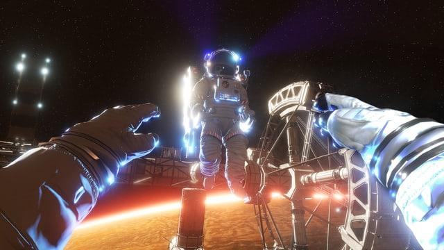 Eine Szene aus dem VR-Erlebnis «The Martian VR Experience»: Die Hände eines Astronauten greifen nach einem anderen Astronauten.